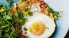 Parmesan Fried Eggs with Bitter Greens Grated Parmesan becomes irresistibly crisp and lacy when added to a hot skillet, taking ordinary fried eggs to new heights. Egg Recipes, Brunch Recipes, Breakfast Recipes, Cooking Recipes, Breakfast Time, Breakfast Ideas, Brunch Dishes, Vegetarian Breakfast, Savory Breakfast