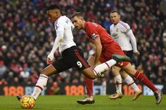 Manchester United's French striker Anthony Martial sends a shot wide during the English Premier League football match between Liverpool and Manchester United at Anfield in Liverpool, northwest England, on January 17, 2016.