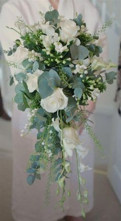 Don't like the teardrop shape but love the wildness and diff shades of green Trailing bouquet - Lily of the valley, eryngium, roses, dendrobium orchid & eucalyptus Orchid Bouquet Wedding, Cascading Wedding Bouquets, Bride Bouquets, Bridal Flowers, Floral Wedding, Orchid Flowers, Trailing Bouquet, Cascade Bouquet, Eucalyptus Bouquet
