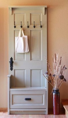 "DIY - turn an old door into a super cute hall tree with a bench. Click on the picture which will take you to the link. Then scroll down the page and under the picture you will find this link that says ""Go to The Friendly Home to see how Hillary made it."" Click on that link to find further directions."