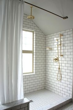 white subway tile, white vintage hex tile, dark grout, brass fixtures