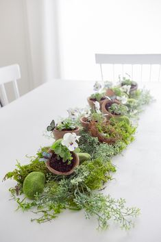 Pretty natural moss with greens and pansies table centerpiece http://www.craftberrybush.com