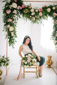 Beautiful bridal bouquet matched by a blooming floral arch