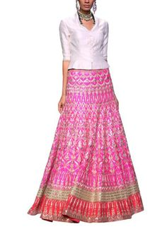 The mix of traditional and contemporary elements in Anita Dongre's vivacious hot pink lehenga exudes pure grandiose! Customary gota pati has been meticulously embroidered on this drop dead gorgeous lehenga, while the ensemble's modern luxe appeal comes together with a fitted buttoned down sleek white bandi. Accessorise with statement jewellery and you are sure to be the most elegant bride. #anitadongre #lehenga #gotapati #bandi #traditional #embroidery #modernluxe #elegant #bride #wedding