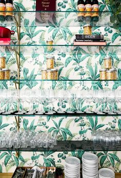 The palm tree motif paper lining one of the bar's walls was salvaged from an '80s home in Miami to bring some Art Deco flair to the space.