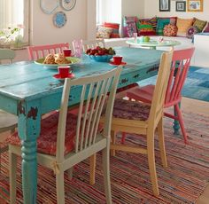 distressed table and chairs. would use different colours for the chairs though.