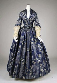 1840 bell silhouette. Detailed, wide collar, lower waist.
