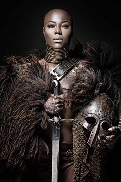 Beautiful black warrior princess holding a sword in studio shot Warrior Princess, Warrior Queen, Fantasy Warrior, Woman Warrior, Medieval Combat, African Beauty, African Art, Tribal Warrior, African Warrior Tattoos