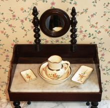 """Toilet set made of porcelain, hand-painted, hand-gilded gold. Pitcher measures 2 1/2"""" tall, bowl 3 1/2"""" in diameter, toothbrush or comb dish 3 1/4"""" long by 1 3/8"""" wide, soap dish 1 3/8"""" by 1 3/4""""."""