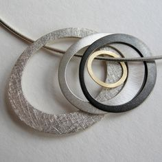 """Pools"""" by Dot Sim – available at http://www.lovedazzle.com/shop/Necklaces-Pendants-by-Dot-Sim-Pools-Necklace.aspx"""