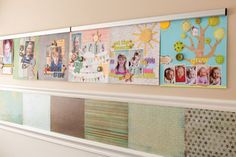 Put two chair rails all the way around the room to slide in kids' artwork...have some squares that are chalkboard or cork board too.