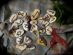 This is a 24-piece painted rune set made of shell fragments. Runes come with a green knit-bag. Each fragment in this set has been specially chosen for their variations of purple and white colors. May be purchased at http://harthandicraft.storenvy.com/products/3436872-purple-rune-set #pagan #rune #runeset #harthandicraft