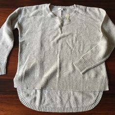 Madewell sweater, current season! Cute, super soft cotton sweater from Madewell.  It is size XS and cut to be a bit over sized.  Features a textured knit and high low design.  This item is NEW with tags! Madewell Sweaters Crew & Scoop Necks