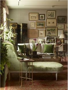 Traditional (Victorian, Colonial) Living Room by Charlotte Moss.  Grass green and multiplicity of mismatched frames = welcoming.