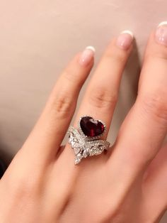 Alluring heart shape ruby and diamond ring , set in white gold White Gold Jewelry, Diamond Jewelry, Jewelry Rings, Jewelry Accessories, Fine Jewelry, Jewelry Design, Ruby Diamond Rings, Jewlery, Wedding Ring Designs