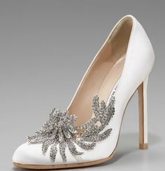 "Satin pump features crystal-beaded vine applique angled across vamp and outer side. Almond toe. 4"" covered heel. ""Swan"" is made in Italy."