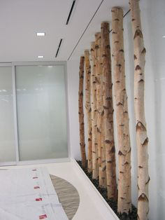 Birch poles and black pebble stones on both sides for an entry way or hallway in spa.