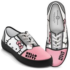 Hello Kitty® color block sneakers with Hello Kitty portrait and name on canvas uppers, rubber soles. Enameled Hello Kitty charm hangs from laces