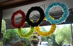 A florist has been ordered to take down an Olympic themed window display - after being warned she is breaching copyright laws. Lisa Cross was stunned when trading standards officials warned she faced legal action if she does not remove a tissue paper Olympic rings display in her shop window.