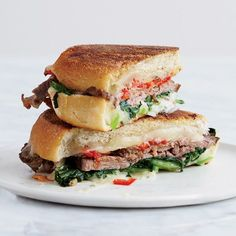 Beef, Broccoli Rabe and Provolone Panini | This is a stellar combination of juicy roast beef with bitter broccoli rabe and melty provolone cheese.