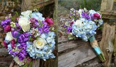 Blue, purple, & white bouquet wrapped in aqua and twine from Gatlinburg's Little Log Wedding Chapel at www.logchapel.com