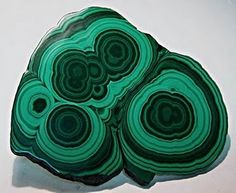 Malachite. I love the look of this stone but personally cannot wear it.. every time I've tried, it's made me feel physically ill- headache and nausea. strange, but true.