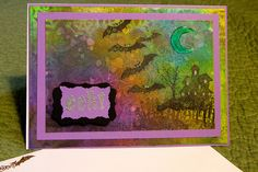 Mixed Media Halloween Card ~ Made with multiple layers of Dylusions ink sprays, Perfect Pearls Sprays, Distress Stamp pads, and gel pens. Cloud Nine images stamped in Staz On inks. Moon embellished with Glossy Accents. Bat eyes are Viva's Pearl Pen. By Daryne Rockett #Halloween #Card #MixedMedia