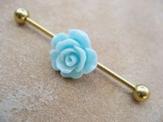 Light teal rose on a titanium 1 inch, 14 gauge barbell. Industrial Barbell Earring Piercing- Mint Green Rose Flower Titanium Gold Bar 14 g Industrial Earrings, Industrial Piercing Jewelry, Industrial Barbell, Industrial Bars, Barbell Piercing, Piercing Tattoo, Cute Jewelry, Body Jewelry, Jewlery