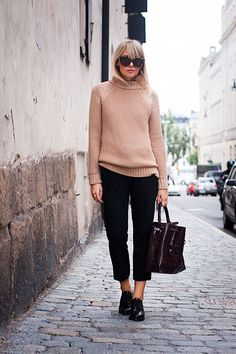 Charlotte Hellberg is wearing a knit top and bag from Zara, trousers from J. Crew, shoes from TopShop and sunglasses from Karen Walker