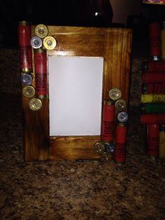 My shotgun shell wooden frame! Stained a cheap wooden frame from Walmart then hot glued shotgun shells to it! Good man gift