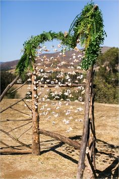 Hanging heart shaped flower wedding arch for ceremony. Captured By: Jen Rodriguez ---> http://www.weddingchicks.com/2014/05/26/bacon-and-eggs-picnic-wedding-reception/