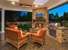 Outdoor living room behind Architectural Designs House Plan  23642JD. Ready when you are. Where do YOU want to build?