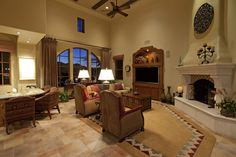 like placement of fireplace and TV.Large living room space features bar area in one corner, fireplace in opposite, with stone flooring, patterned aztec style rug, and exposed beams on two story height ceiling. Small Living Room Design, Elegant Living Room, Spacious Living Room, Family Room Design, Beautiful Living Rooms, Formal Living Rooms, Small Living Rooms, Interior Design Living Room, Living Room Designs