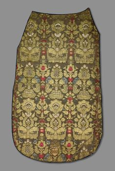 """This textile piece is called, """"Chasuble Front.""""  The piece is from Italy that dates back to the early 15th century. It is made out of velvet and silk, where it contains a luxurious background of red, cut-pile velvet of interlacing vegetation and abstract floral elements further embellished with brocaded pomegranates and floral motifs all in metallic threads.  Textiles like this were worn by a priest over the white linen robe during services. Pomegranates, Metallic Thread, 15th Century, Pinterest Board, Floral Motif, Priest, Making Out, Dates, Renaissance"""