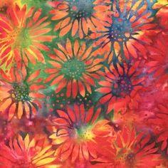 Tissu batik tournesols rouges fond multico jaune bleu