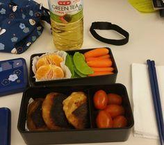 lunch today: potato oyaki tomatoes carrots snow peas and oranges #omnomnom #badfoodphotography #bento