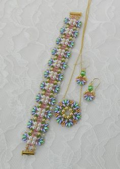 These earrings are great for Spring! Goes with anything & so colorful with pastel colors! I used Genuine Swarovski Gold pearls along with Genuine Swarovski Light Rose crystal bicones with pastel SuperDuo beads and accented by silver lined grass green & galvanized gold seed beads. They