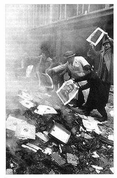 People burning portraits of Stalin and Rákosi. Budapest, October 1956.