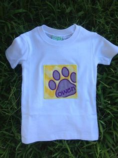 Smock Your Tot - Appliqued Tiger Pawprint Shirt or Onesie with monogrammed name, $24.95 (http://www.smockyourtot.com/appliqued-tiger-pawprint-shirt-or-onesie-with-monogrammed-name/)
