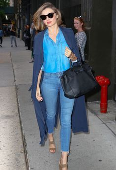 The key to pulling off the look is to choose pieces in contrasting shades of blue. Kerr's shirt is a much brighter hue, making it pop against her faded jeans. Adding in a navy trench coat, her trio of different blue tones is a cool twist on the monochrome look.