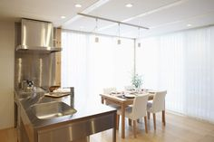 Interior Design, White Dining Chairs Undermount Sink Pendant Lamp Set Transparent Curtain Cooker Hood Wooden Single Hole Faucet Dining Table Wooden Floor Steel Kitchen And Electric Ranges ~ Lovely Open Plan Interior with Spacious and Minimalist Impression