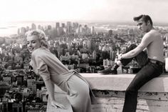 Marilyn Monroe and Elvis Presley take in the sights of a rooftop view.