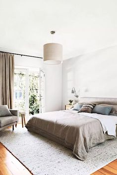 Optimize your bedroom and balance the energy that flows in an around your room with these feng shui tips.