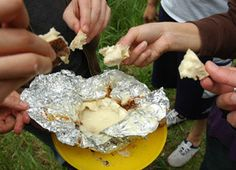 Yummy Campfire Cheese~~~    This easy haute-camping treat makes a great midnight snack just as the fire is dying down. It's pretty satisfying to sop up molten cheese with hunks of crusty bread while in the woods.
