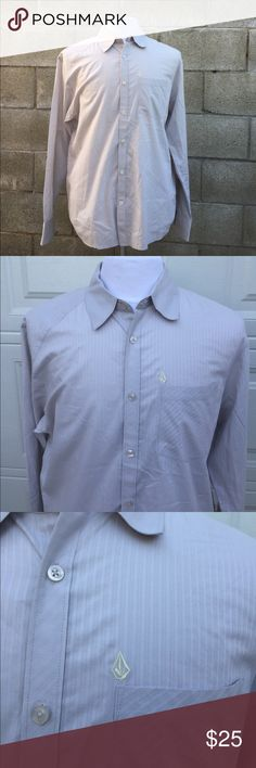 """Volcom Button Down shirt stripes Light grey Large Volcom Button Down shirt stripes Light grey Large. Volcom design print on lower backside of shirt and of course the iconic Volcom logo above front chest pocket. Grey soft blended in stripes. Verrrrrry nice. Gently used with small stain on back of collar (seen in picture) in overall good condition.   MEASUREMENTS:  armpit to armpit 23 3/4""""  shoulder to cuff 26 1/2""""  Length: collar to hem 30 1/4"""" Volcom Shirts Casual Button Down Shirts"""