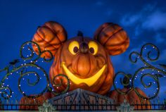 Mickey's Halloween Time Halloween time is not Halloween time without a good Mickey pumpkin. This one glowingly greets you as you enter the. Read more here at Tours Departing Daily Disney World Halloween, Mickey Mouse Halloween, Disneyland Halloween, Holidays Halloween, Halloween Party, Disney Holidays, Halloween Stuff, Halloween Pumpkins, Halloween Decorations