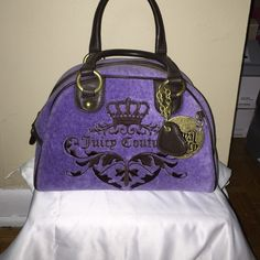 Juicy Couture Purse Only been used twice. Fabric is very clean. Length: 10 and 1/2 inches. Height: 7 and 1/2 inches. Width: 7inches. There is a matching wallet that I will post separately and would be willing to do a deal for both. Juicy Couture Bags Hobos