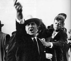 Lyndon B Johnson yelling at the pilots of a nearby plane to cut their engines so John F Kennedy could speak. JFK is seen trying to calm him down. Taken during the presidential campaign of 1960.