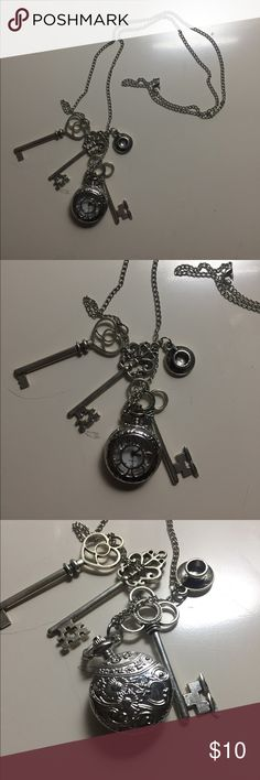 Alice in wonderland watch necklace. Alice in wonderland necklace with pocket watch. Watch works. Has a little teacup and a few keys. In great condition. Has a long chain. Enjoy! Hot Topic Jewelry Necklaces