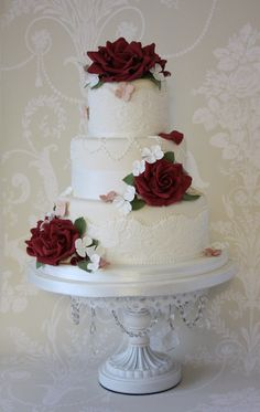 three tier wedding cake with gum paste roses and sugar lace